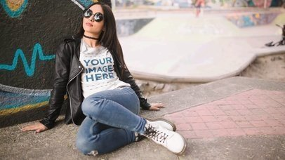 Beautiful Girl Wearing Sunglasses and a T-Shirt While Being in a Skating Park Video Mockup a13514