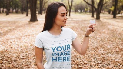 Stop Motion Mockup of a Girl at a Park Wearing a T-Shirt With a Paper Butterfly a13519
