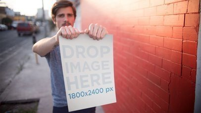 Trendy Guy Holding A Poster In The Street Stop Motion Mockup a13654