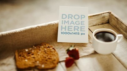 Small Flyer Lying On Breakfast Table While Bread Strawberry Coffee And Spoon Moves a13721