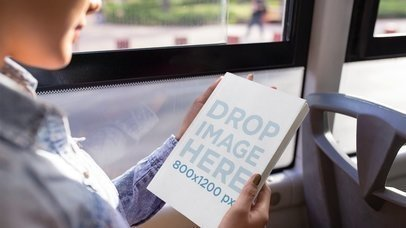 Young Girl Reading Book In A Bus Stop Motion Mockup a13743