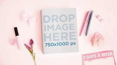 Book Lying On A Girly Desk With Moving Things Stop Motion Mockup a13824
