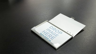 Business Card In Card Holder Over A Black Surface Stop Motion Mockup a13710