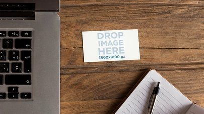 Business Card Moving On A Wooden Desk With MacBook Note Pad And Pen Nearby Mockup Stop Motion a13869