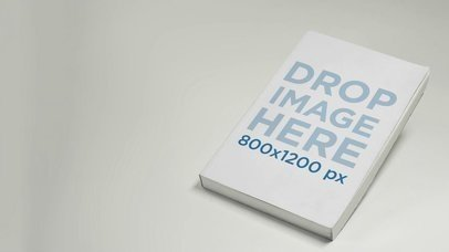 Book Lying On A White Surface Video Mockup a13991