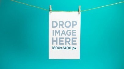 Video Mockup Of A Flyer Hanging From A Rope Against A Turquoise Background a13963