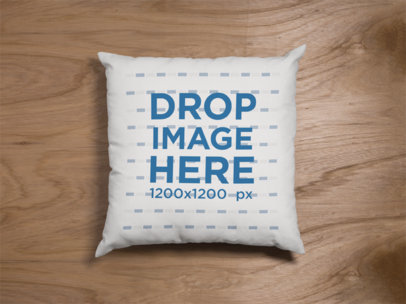 Mockup of a Square Pillow Lying on a Wooden Surface a15120