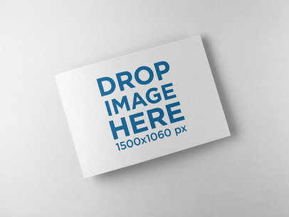 Closed Booklet Mockup Lying on a Solid Color Surface a15097