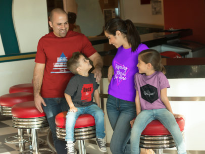 Family of Four Wearing Different T-Shirts Mockup From One Another Having Fun in a Burgers Restaurant a15481