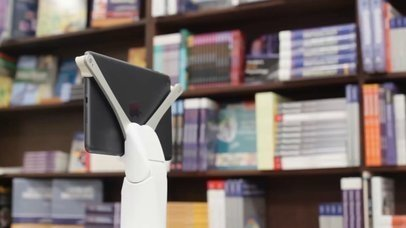 App Demo Video of an iPad in Landscape position Standing at a Library Near a Man Reading a15762