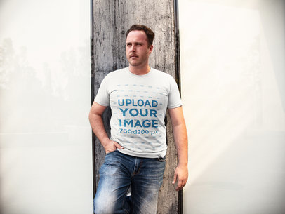 Mockup of a White Man Standing Between Two Windows While Wearing a Round Neck Tshirt a15889