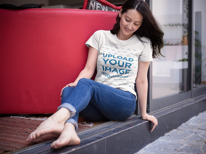 Middle Aged Woman Without Shoes Sitting Down While Wearing a Tshirt Mockup a15917