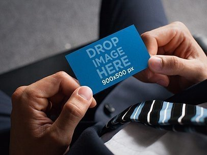 Business Card Mockup Featuring a Businessman Holding a Business Card a6141