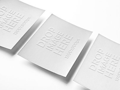 Mockup of 3 Business Cards Lying Over a Smooth Background a6305