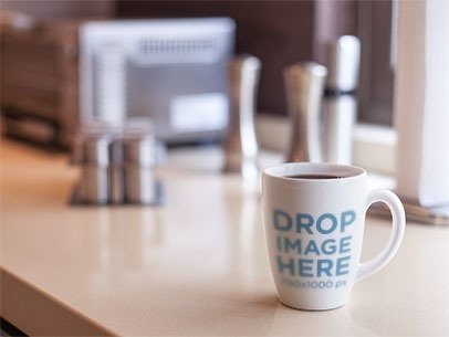 Cup Mockup Featuring a Coffee Cup on Top of a Kitchen Counter a5847