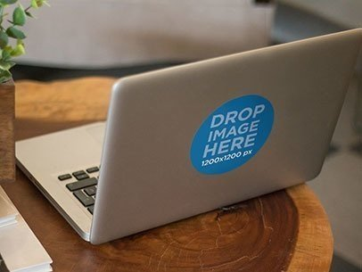 Branding Mockup Featuring a Decal Laptop Sticker on a Macbook Pro a6815