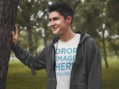 T-Shirt Mockup Template of a Young Man in a Nature Environment 5555a