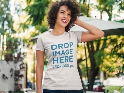 Curly-Haired Woman Standing Outside a Cafe T-Shirt Mockup a8358