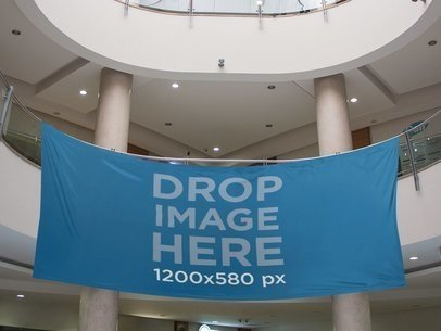 Horizontal Banner Mockup Hanging From a Balcony at a Mall a10597