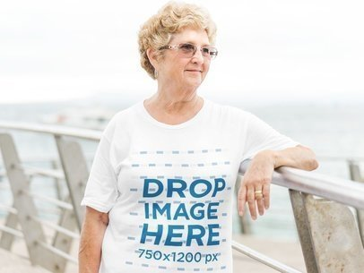 T-Shirt Mockup of an Elderly Woman in an Outdoor Environment a10935