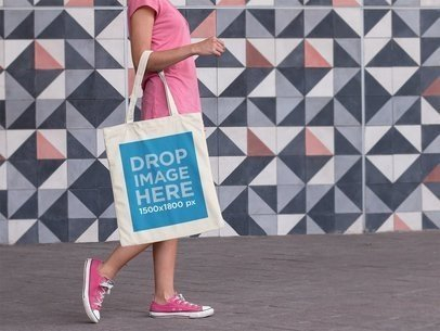 Tote Bag Mockup Carried by a Woman Walking a11451