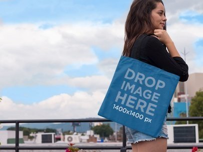Pretty Woman Carrying a Tote Bag Over Her Shoulder Mockup a11463