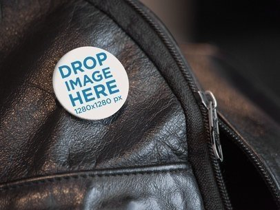 Mockup of a Button on a Black Leather Backpack a14321
