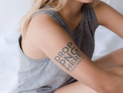Mockup of a Tattoo on a Blonde Girls Upper Right Arm a14491