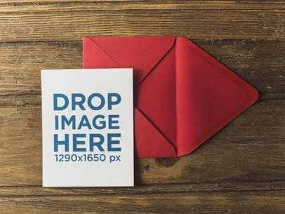 Invitation Template on a Red Envelope over a Wooden Table a14713