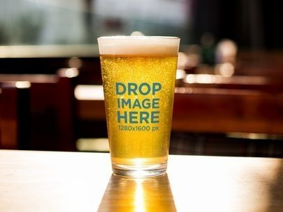 Golden Pint Beer Glass Template On a Table a14782
