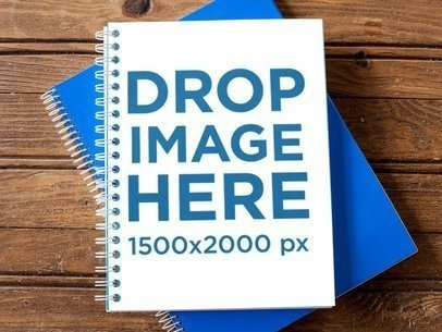 Spiral Notebook Template Lying Over Another Blue Notebook on a Wooden Surface a14835