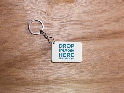 Keychain Mockup Lying on a Wooden Surface a15407